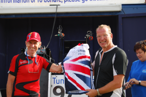 John Watson (right) receives his autographed HB jersey from former Olympian Willi MooreJohn Watson received his autographed jersey from former Olympic track cyclist Willi Moore, who designed the course for the Red Kite Ride.