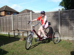 Niamh wearing a Marlow Riders jersey with her new trike funded by the Red Kite Ride